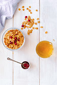 flakes for breakfast with honey on wooden bacgkround top view