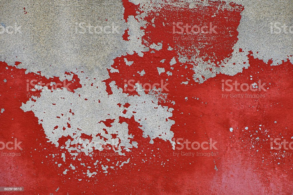 Flakes of old red paint on grey concrete wall royalty-free stock photo