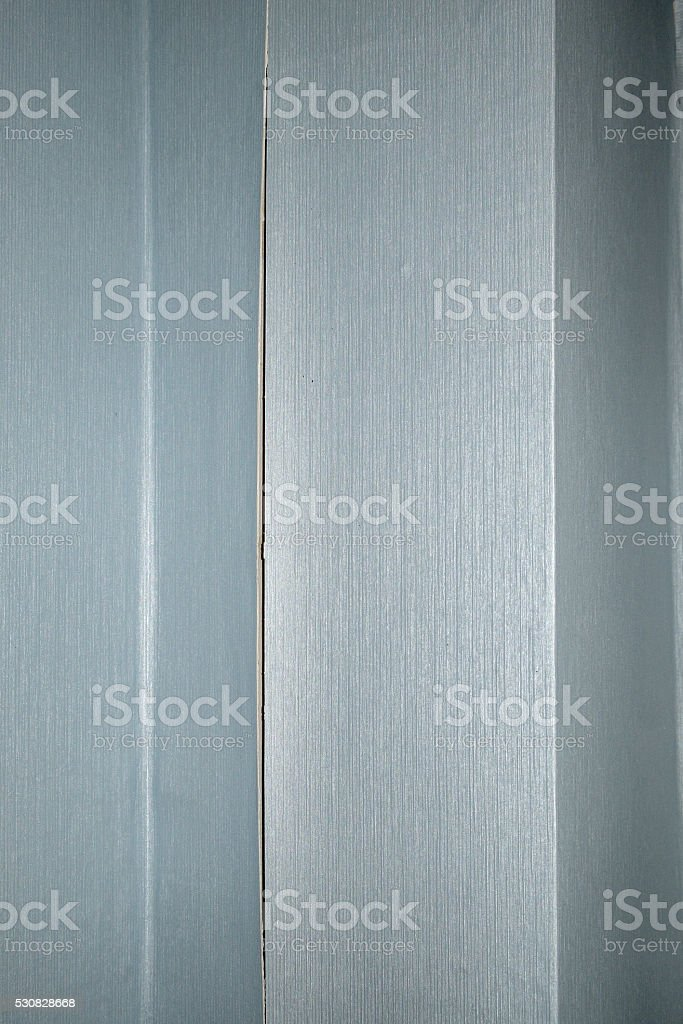 flaking and crack at the junction of the wallpaper stock photo