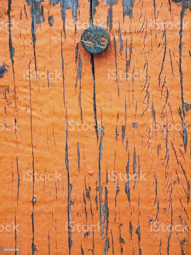 flaking paint on aged wood with sea level datum stock photo