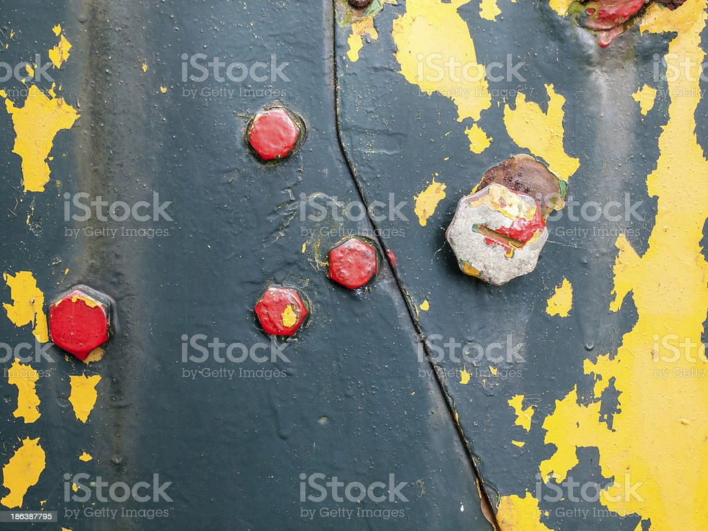 flaking paint on rusty iron with bolts royalty-free stock photo