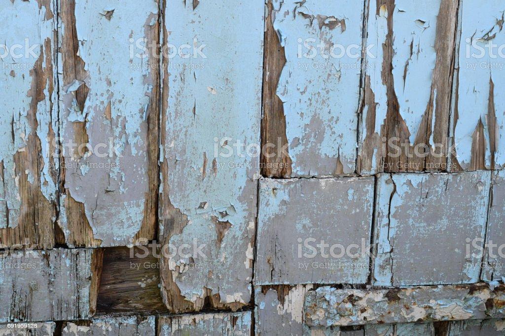 Flaking paint on weathered wood stock photo