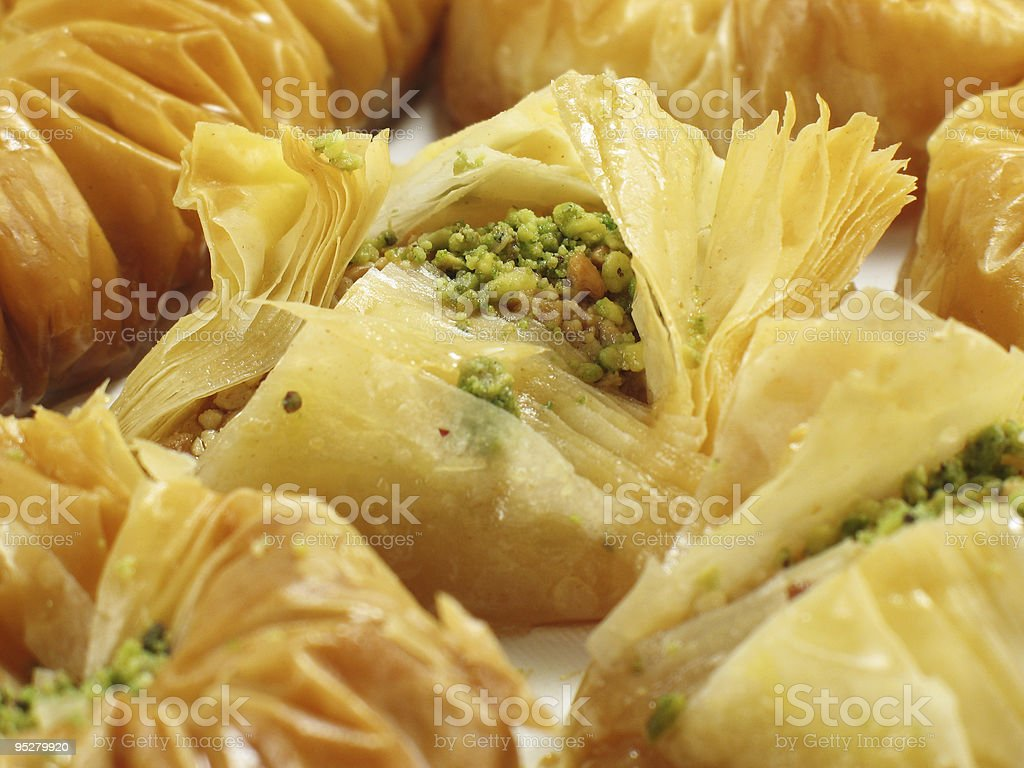 Flaky baklava with pistachio nut center stock photo