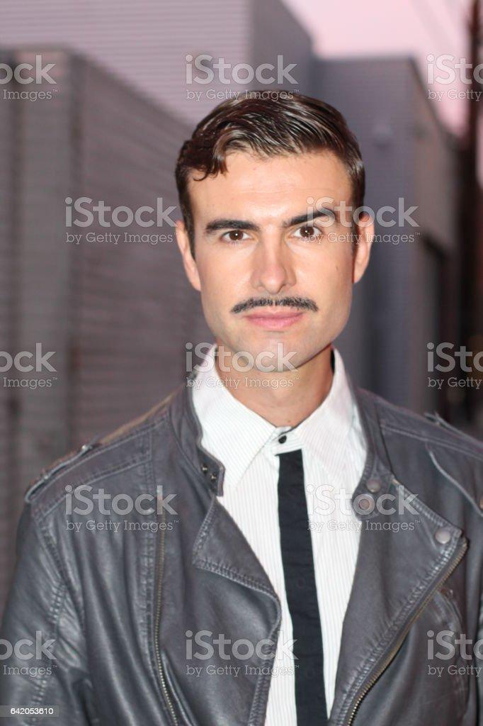 Flamboyant retro man with mustache stock photo