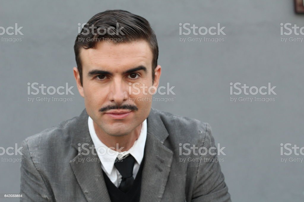 Flamboyant serious retro man with mustache stock photo