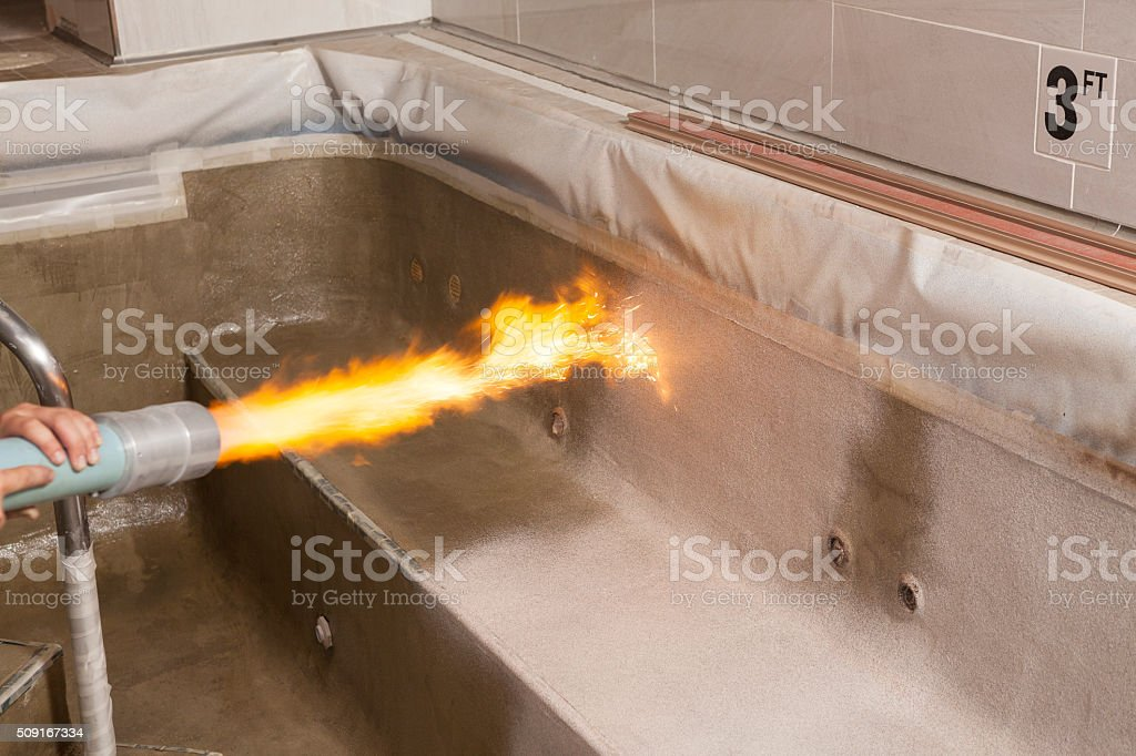 Flame Application of Pool Coating stock photo