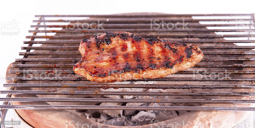 Flame broiled steak on a grill royalty-free stock photo