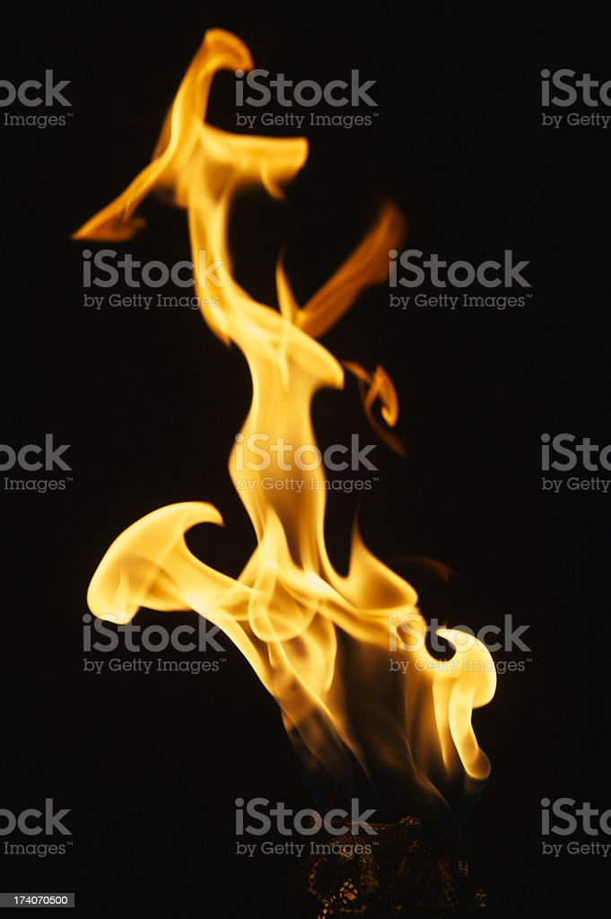 Flame Close Up on a Torch Black Background stock photo