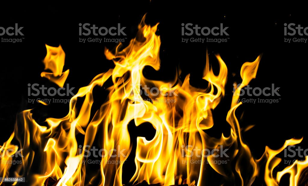 flame fire on black background stock photo
