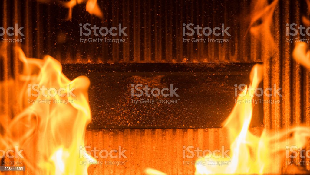 flame in a wood burner stock photo