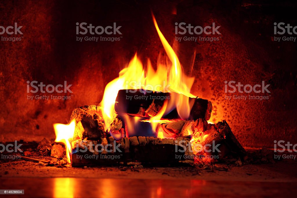 Flame in fireplace. stock photo