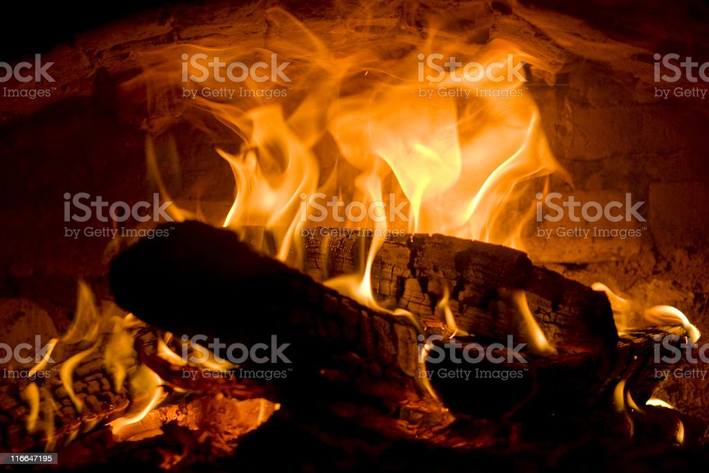 Flame in the fire-chamber stock photo