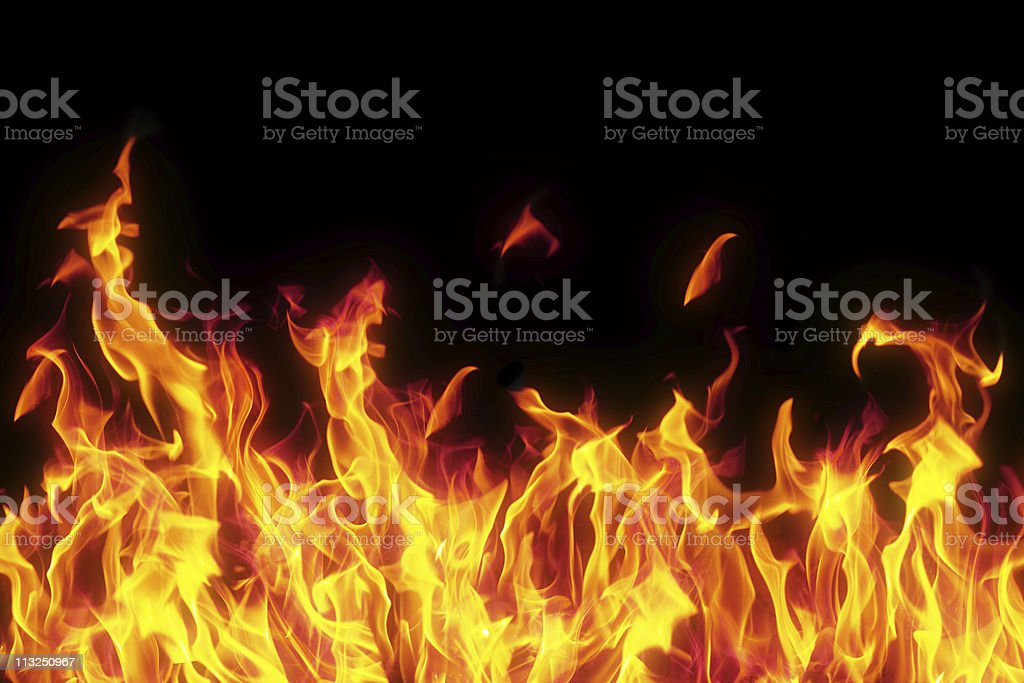 flame isolated over black background stock photo