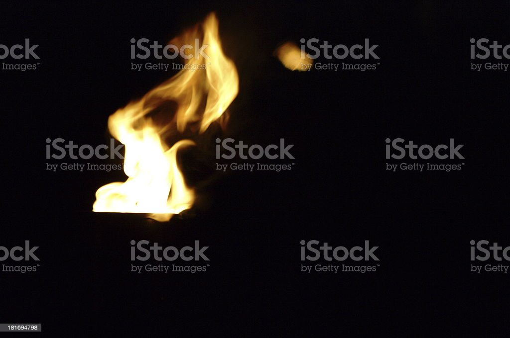 flame of a torch at night stock photo