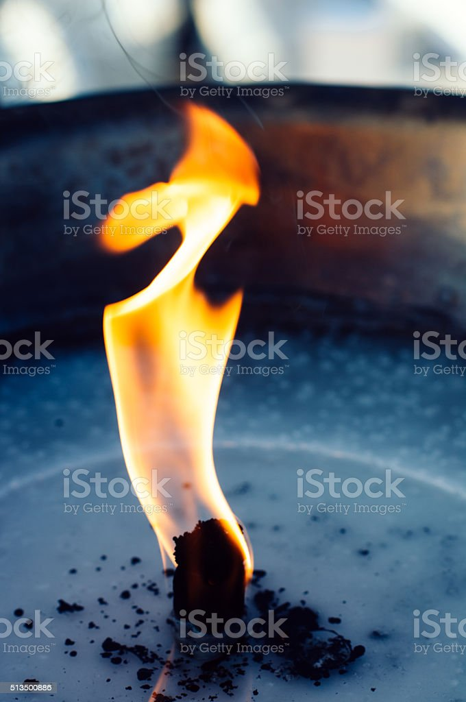 Flame of oil lamp close up horizontal stock photo