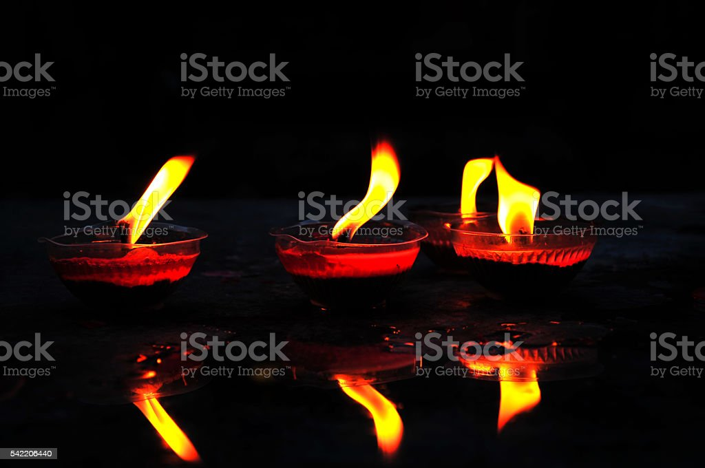 Flame of red candles in temple stock photo