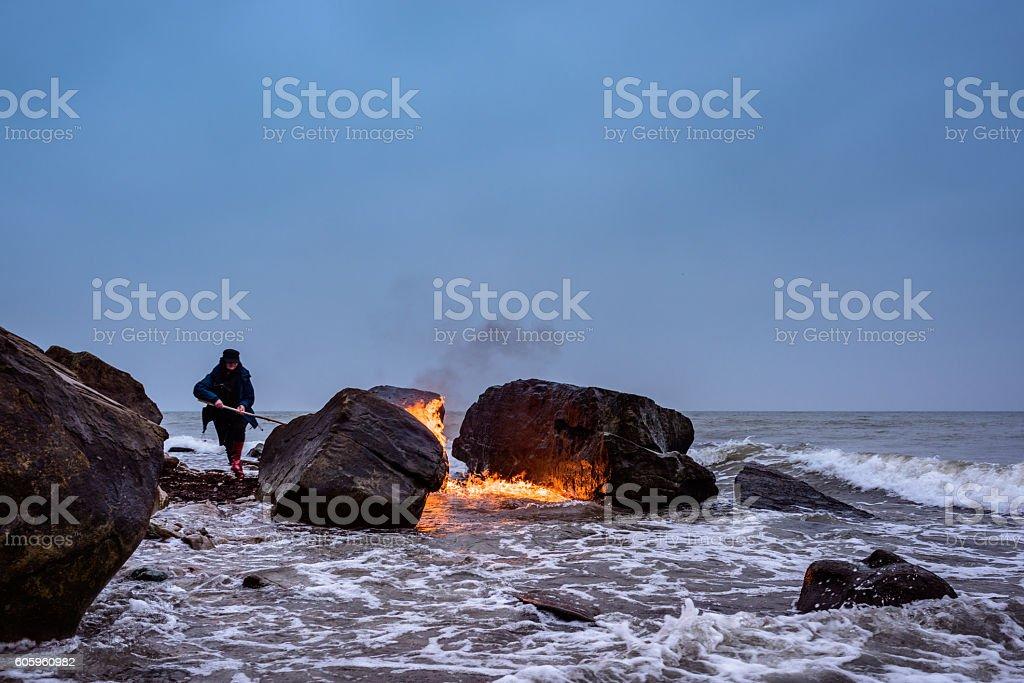 Flame on the seashore stock photo