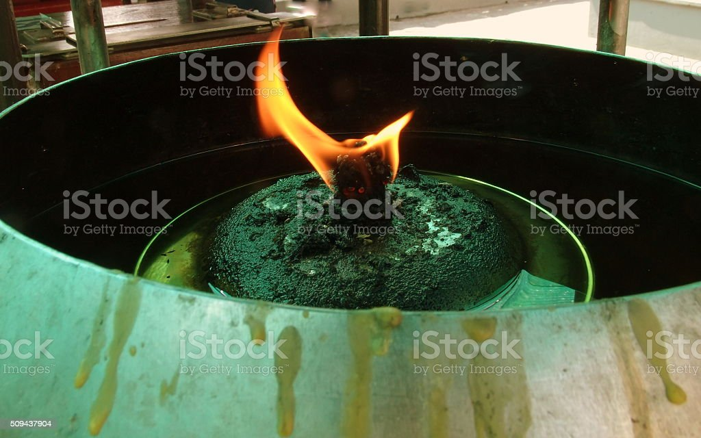 Flame to the wick stock photo
