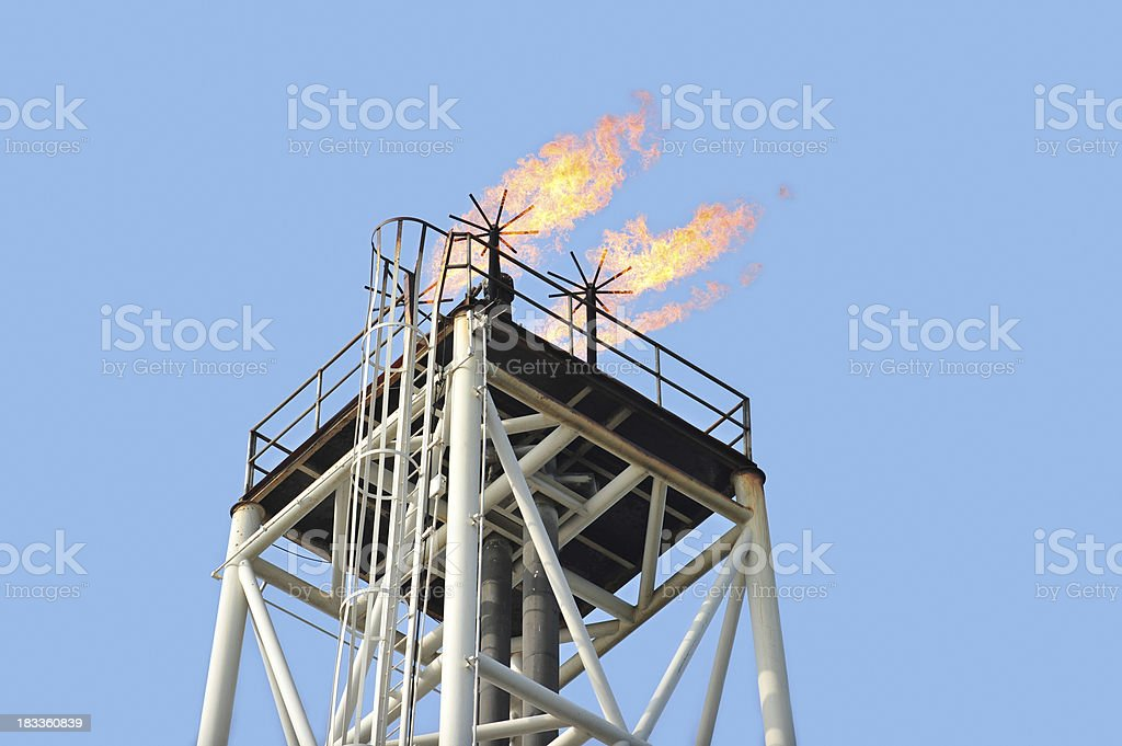 Flame tower at an offshore oil rig gas and Methane royalty-free stock photo