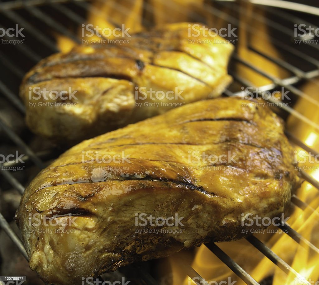 Flame-broiled BBQ chicken royalty-free stock photo
