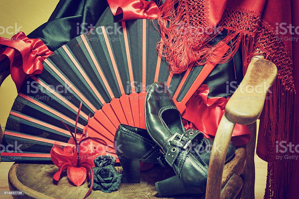 Flamenco clothing on a wooden chair stock photo