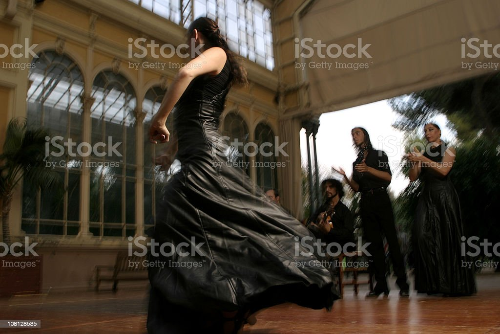 Flamenco Dancer Dancing with People Clapping royalty-free stock photo