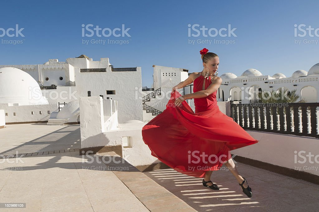 Flamenco dancer outdoors in a red dress stock photo