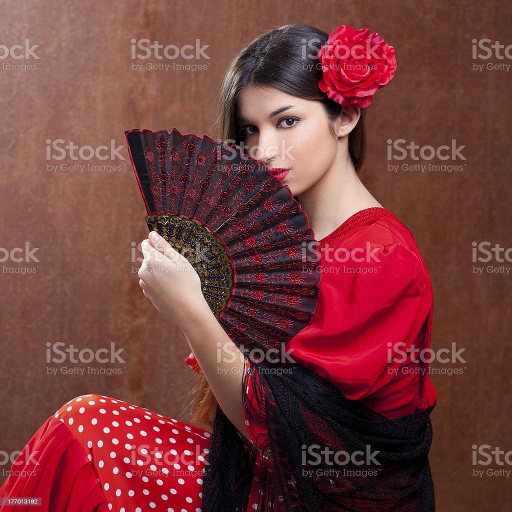 Flamenco dancer woman gipsy red rose  spanish fan stock photo
