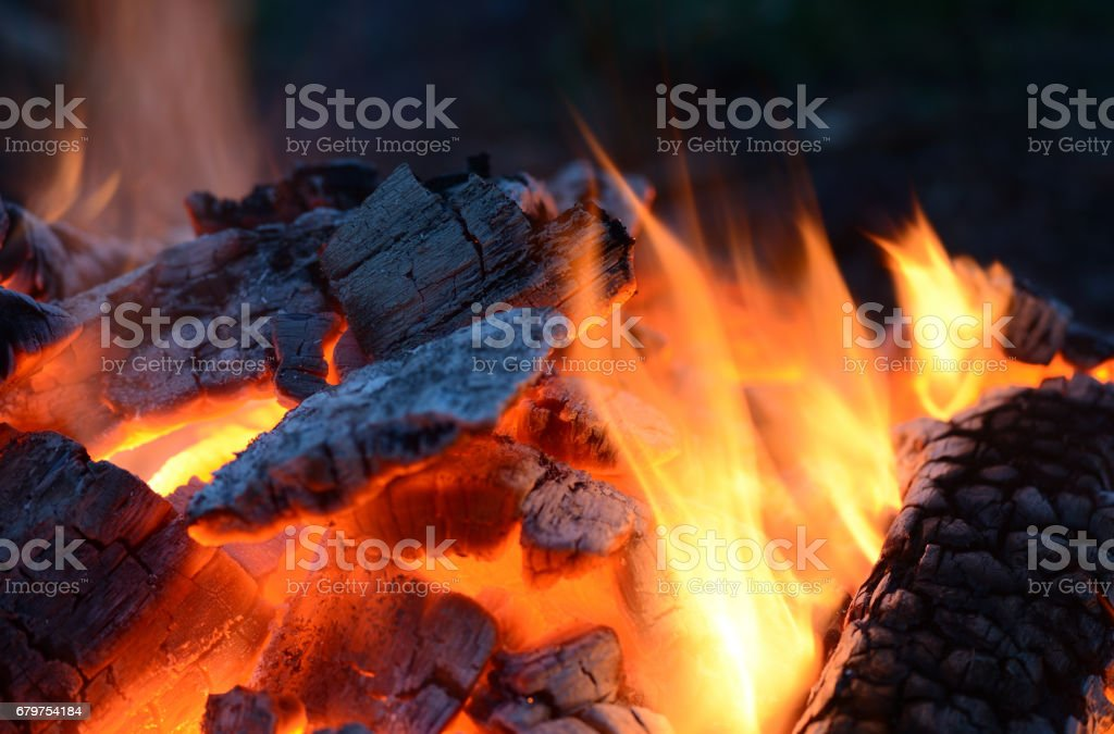 Flames and sparks of a burning fire as the background stock photo