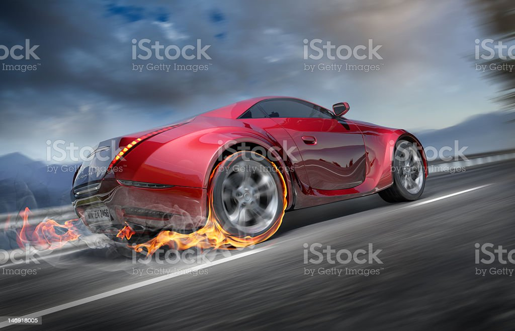 Flames coming from back of fast moving sports car stock photo
