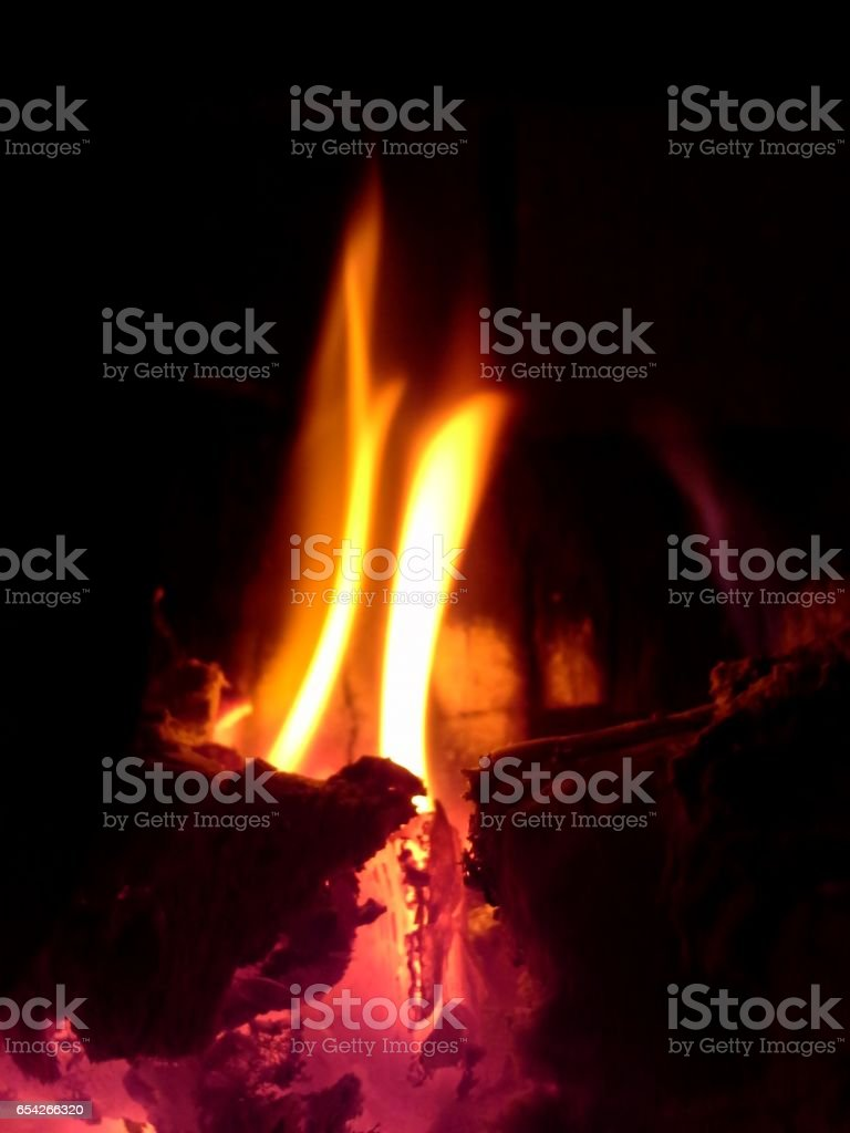 Flames Coming Up Out of Burning Logs stock photo