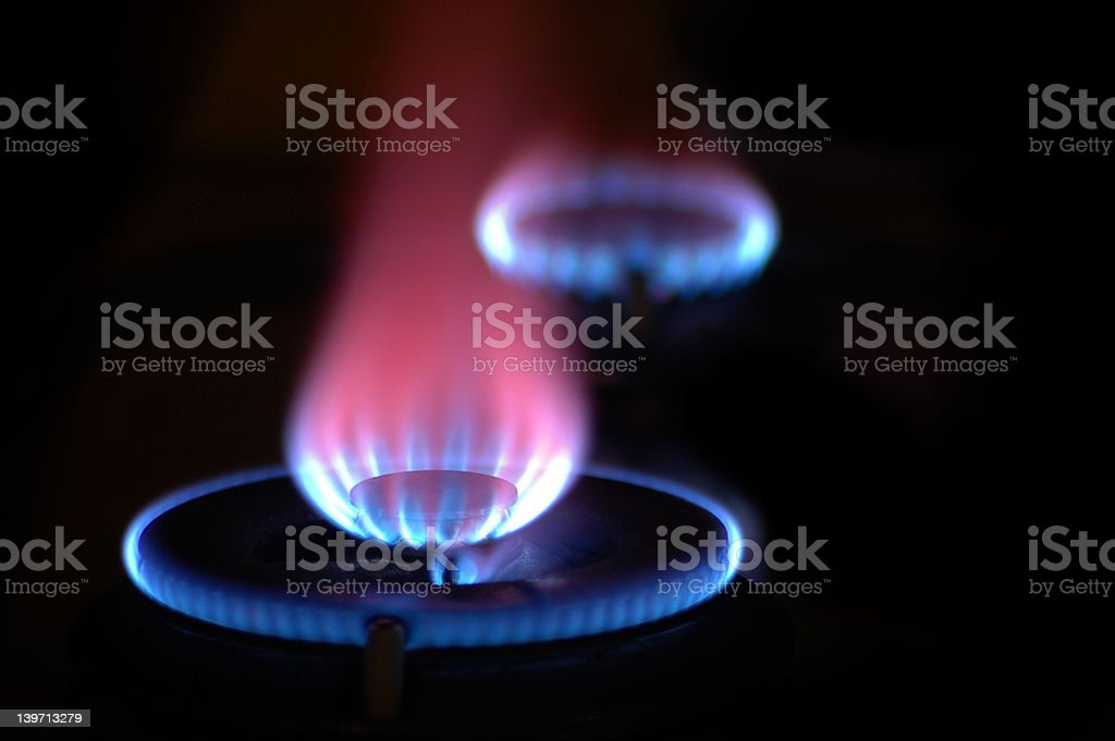 Flames from 2 Stoves royalty-free stock photo