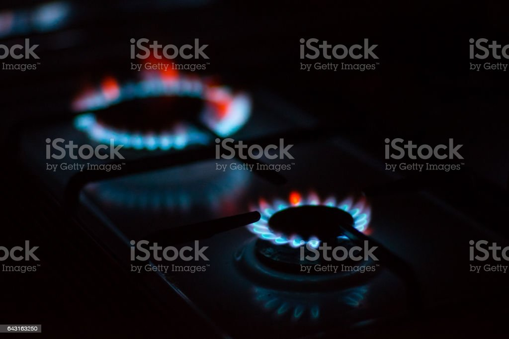 Flames of gas burners on stove stock photo