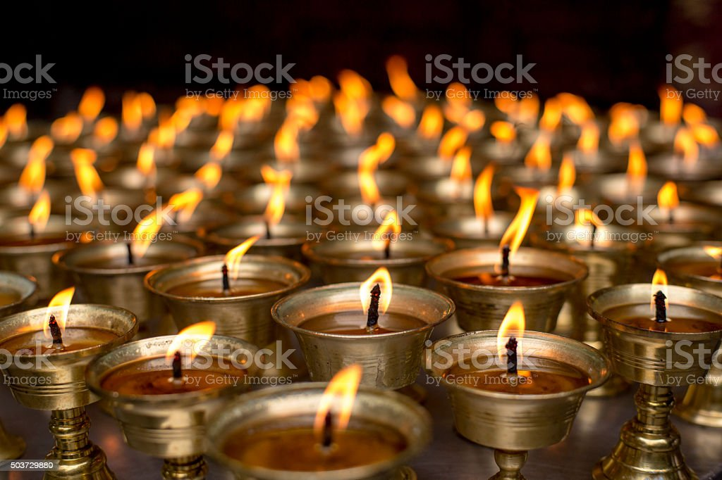 flames of oil lamps stock photo