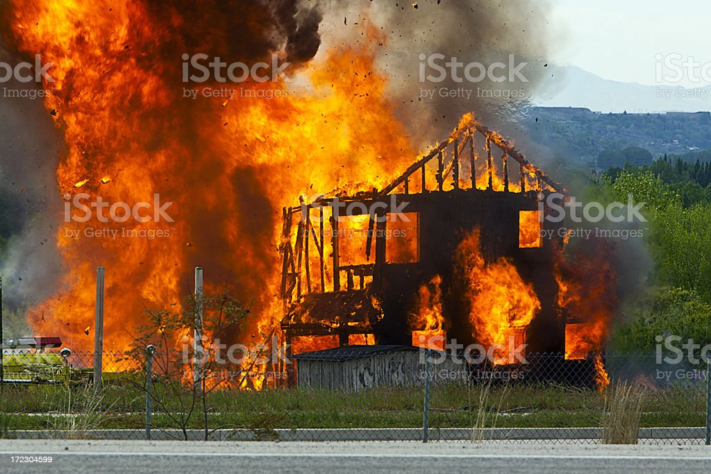 Flames, Smoke Burst in Violent House Fire stock photo