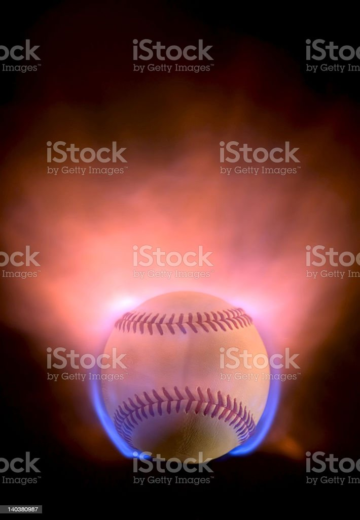 A baseball set alight with glowing blue and orange flames
