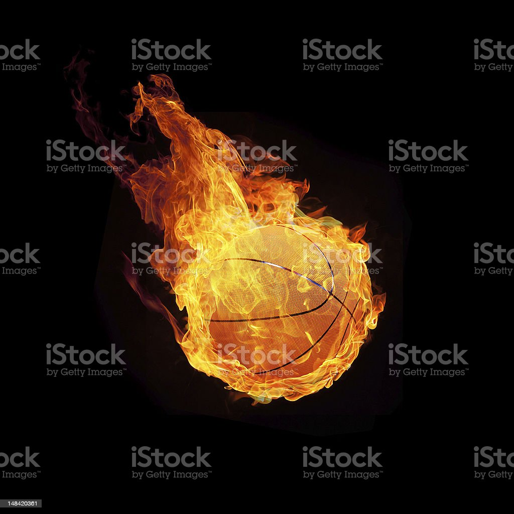 A flaming basketball hurtling toward the ground stock photo
