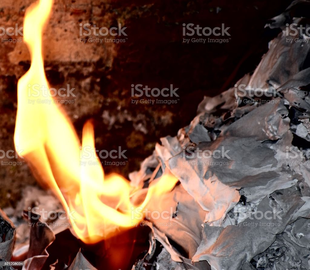 flaming fire burning paper stock photo