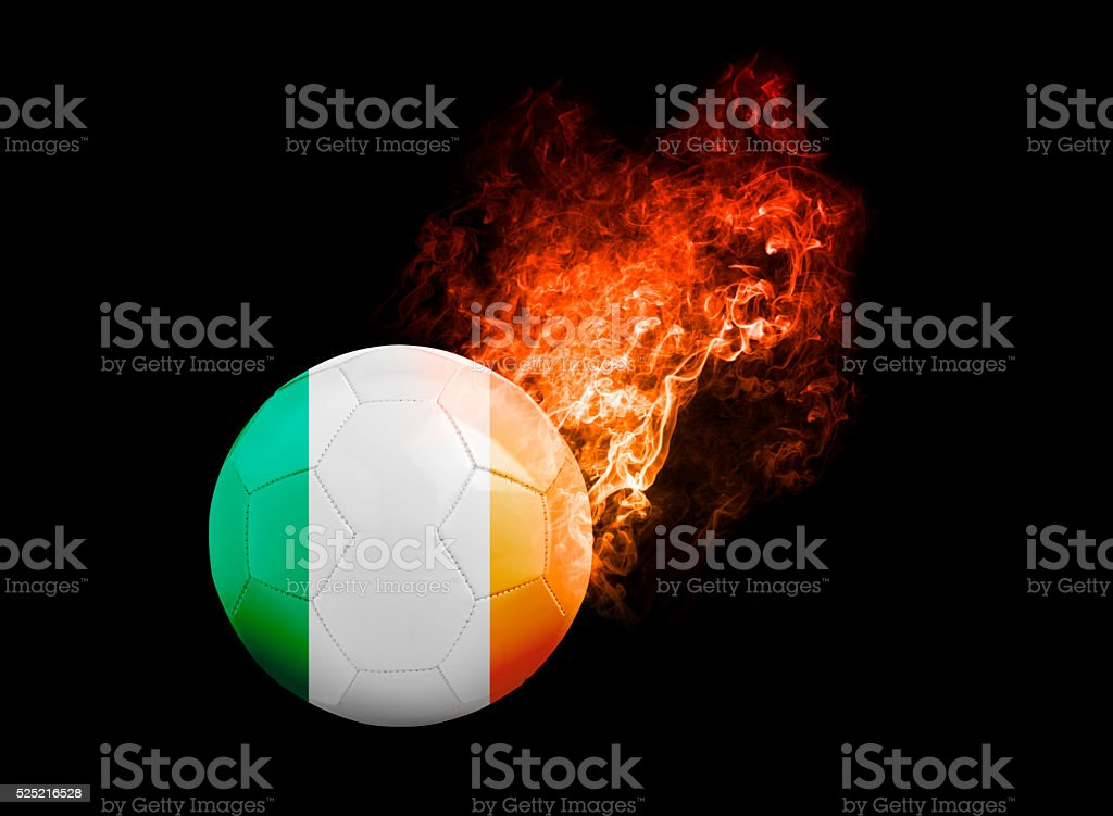 Flaming Football Ball on black background flag Republic of Irela stock photo