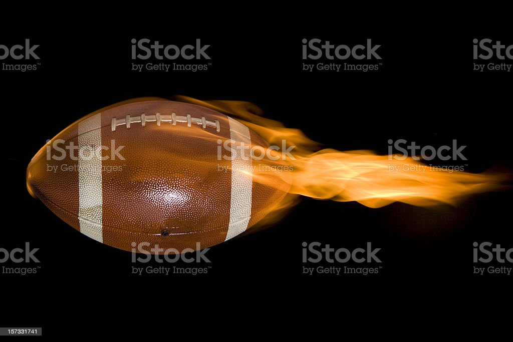 flaming football stock photo