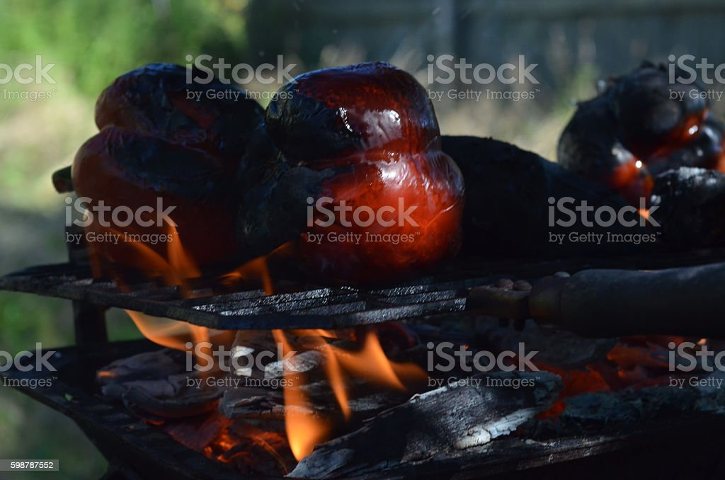 Flaming grill outdoors grilling red bell peppers stock photo
