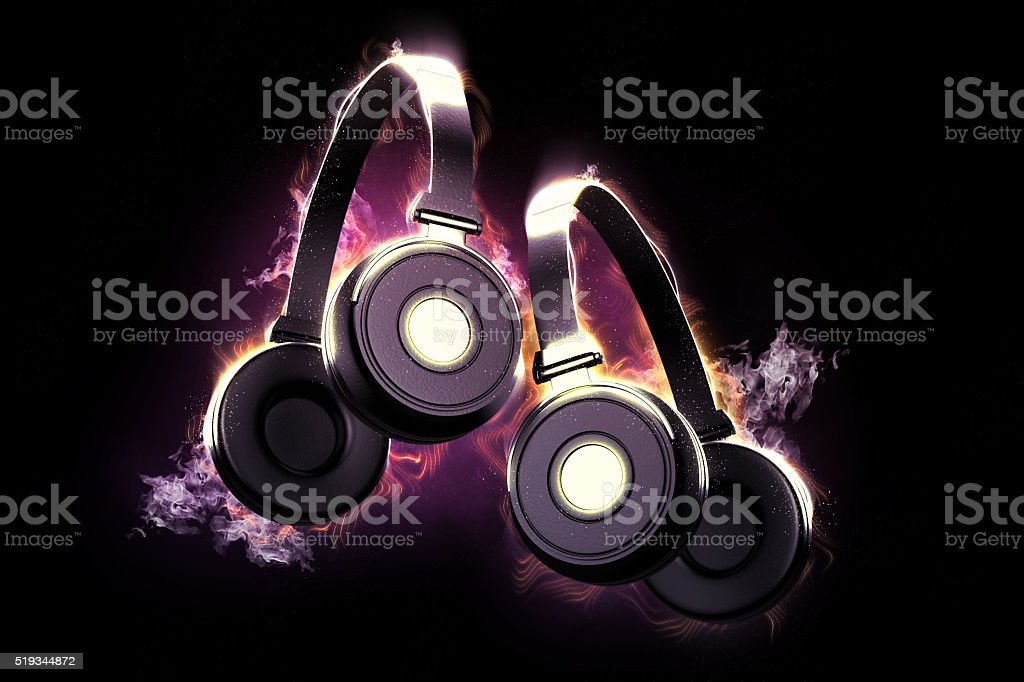 Flaming headphones. Musical concept stock photo