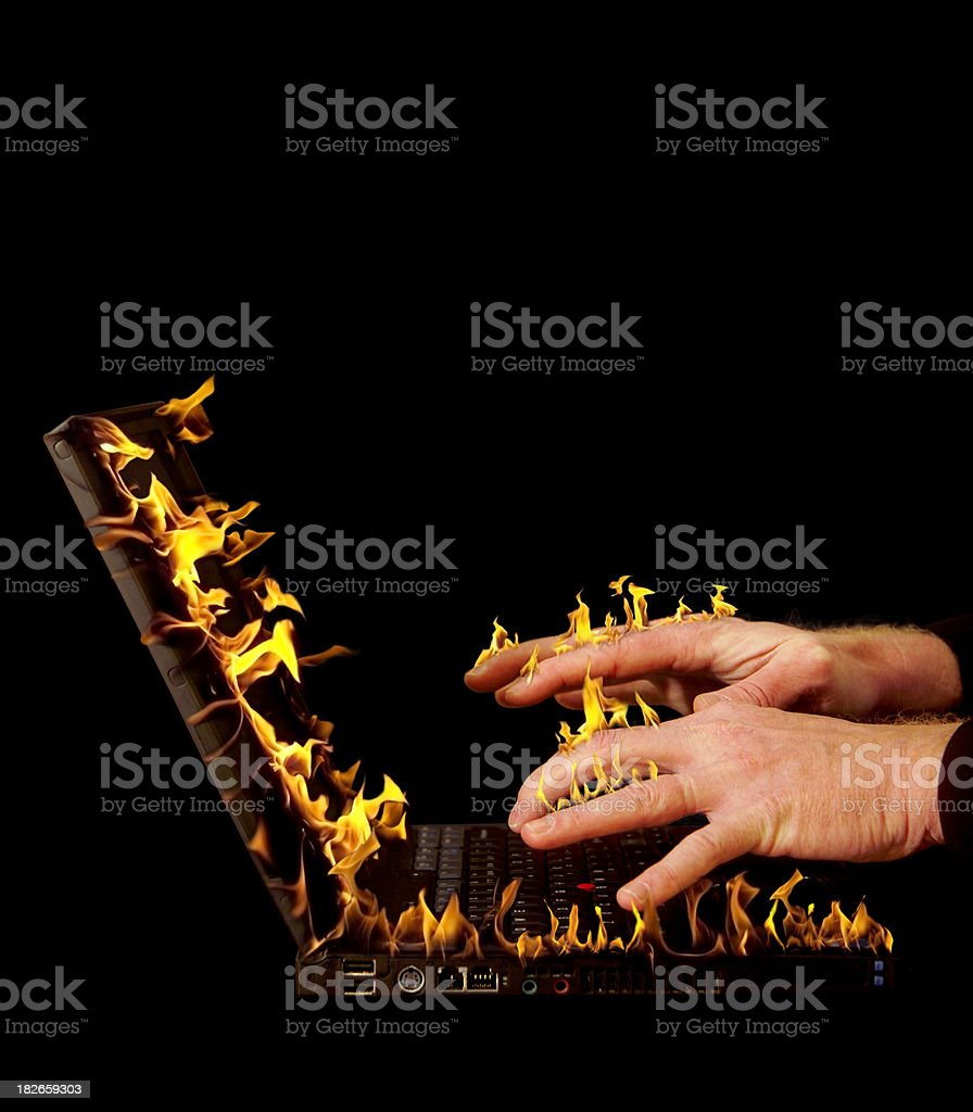 flaming laptop stock photo