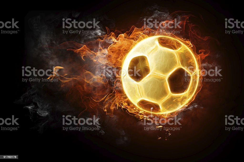 Flaming soccer ball on dark background royalty-free stock photo