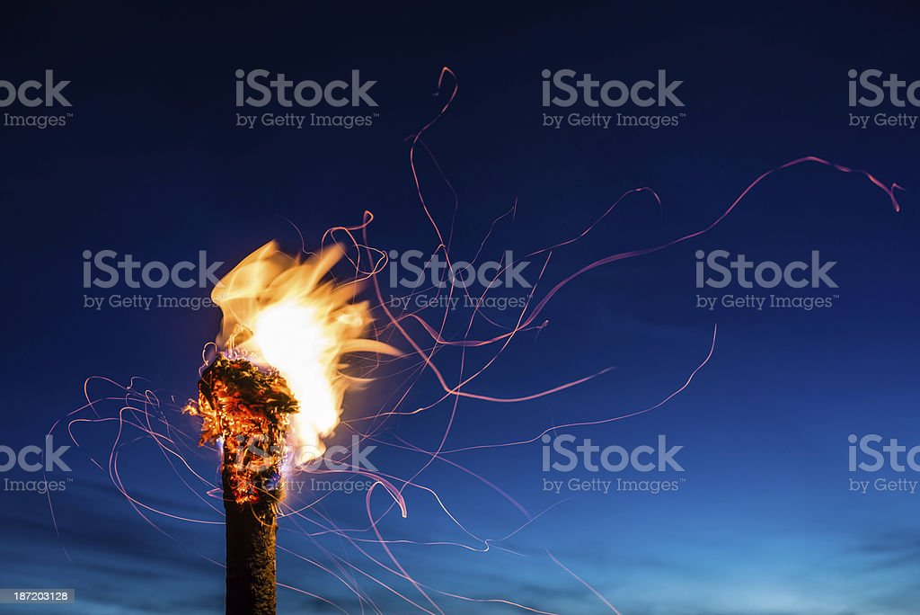 Flaming Torch at Night stock photo