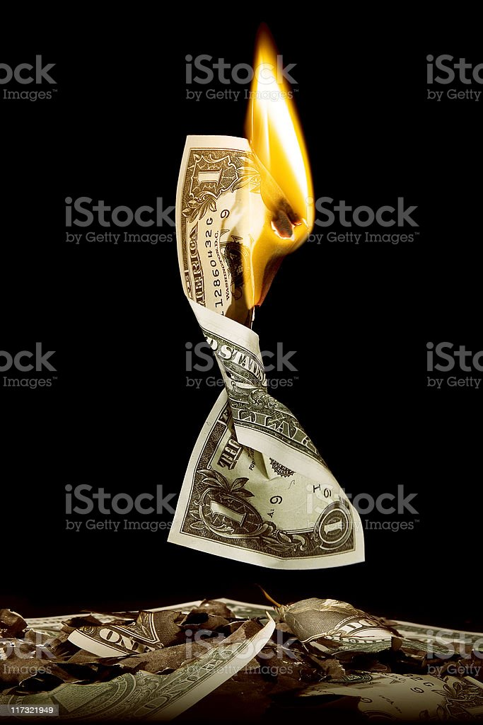 flaming twisted dollar stock photo