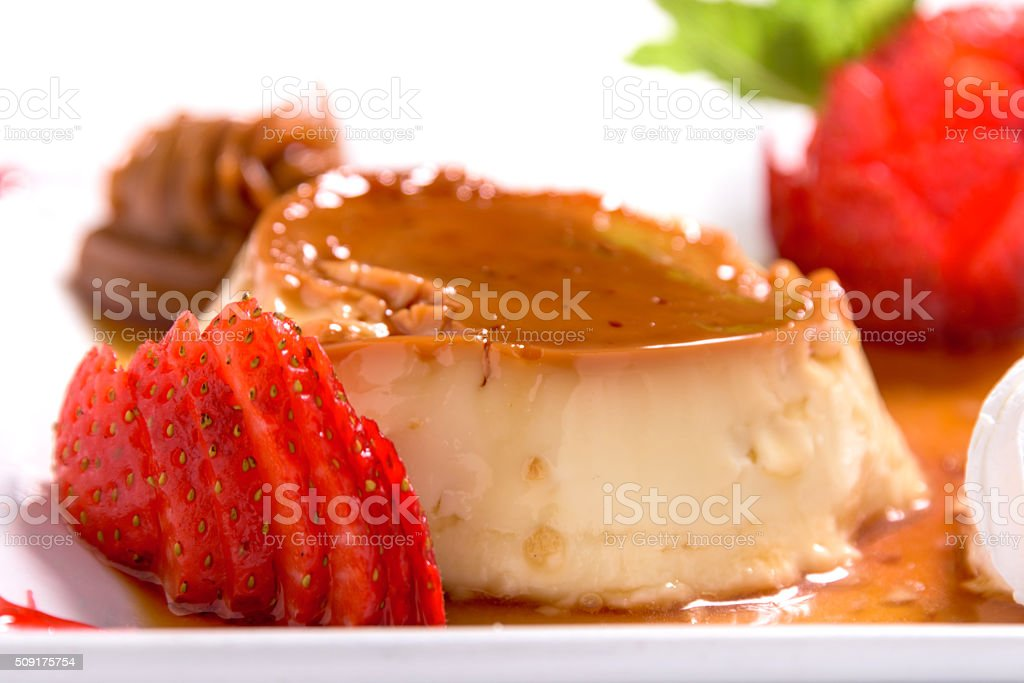 Flan with sliced strawberries stock photo