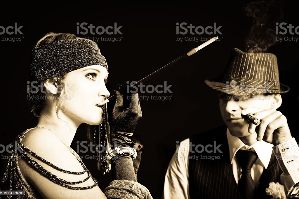 Flapper girl and gangster stock photo