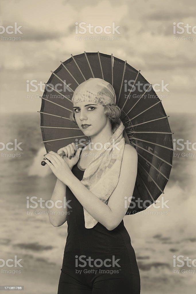 Flapper girl. Under umbrella stock photo