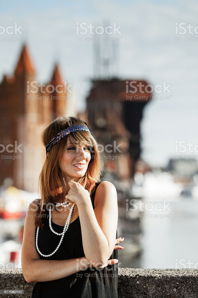 Flapper girl woman in1920s style standing on the street stock photo